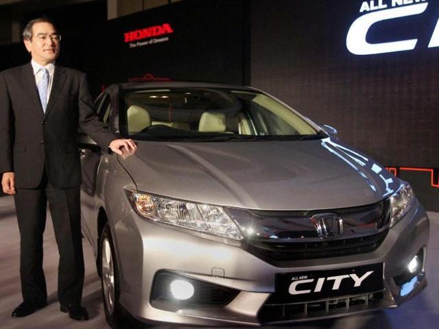 Yoshiyuki-Matsumoto-Managing-Officer-Honda-Motor-poses-with-the-newly-launched-4th-generation-Honda-City-car-at-a-world-premiere-event-in-New-Delhi-on-Monday-Photo-PTI-Shahbaz-Khan
