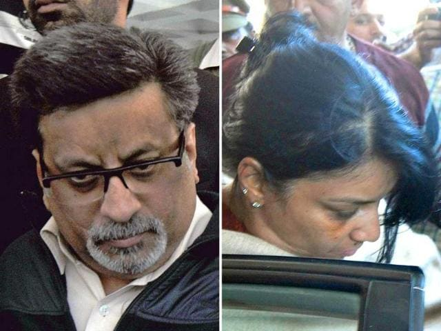 Rajesh-L-and-Nupur-Talwar-have-been-held-guilty-of-murder-of-their-daughter-Aarushi-and-domestic-help-Hemraj-by-a-special-CBI-court-AFP-Photo