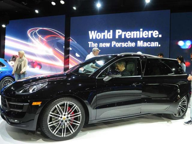 The-2014-Porsche-Macan-SUV-attracts-attention-after-it-was-unveiled-to-the-media-on-November-20-2013-at-the-LA-Auto-Show-in-Los-Angeles-The-LA-Auto-Show-will-be-open-to-the-public-from-November-22-to-December-1-Photo-AFP
