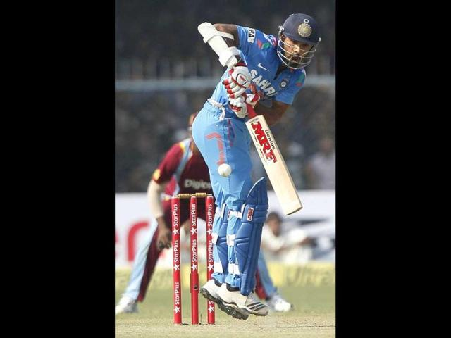 Opener-Shikhar-Dhawan-plays-a-shot-during-the-last-ODI-match-against-West-Indies-at-Green-Park-stadium-in-Kanpur-PTI-Photo