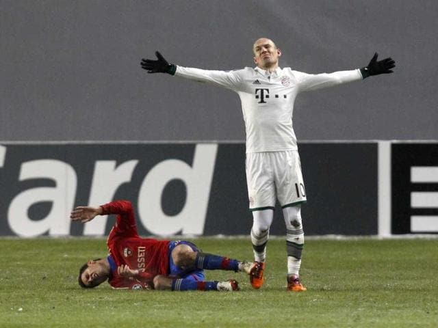 Bayern-Munich-s-Arjen-Robben-R-reacts-as-CSKA-Moscow-s-Georgi-Milanov-lies-on-the-pitch-after-receiving-an-injury-during-their-Champions-League-football-match-at-the-Arena-Khimki-outside-Moscow-Reuters-Photo