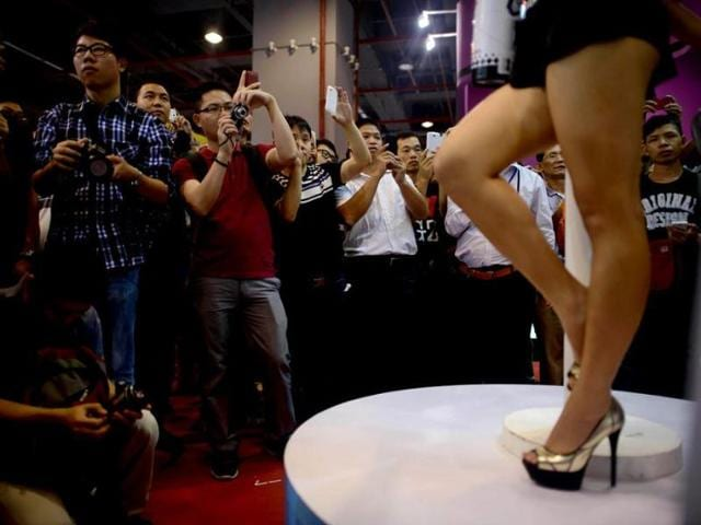 Visitors-take-photos-of-a-model-at-the-Guangzhou-Sex-Culture-Festival-in-the-southern-Chinese-city-AFP-Photo