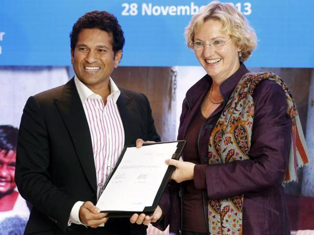 Cricket-icon-Sachin-Tendulkar-L-and-Unicef-regional-director-for-South-Asia-Karin-Hulshof-display-a-certificate-declaring-Tendulkar-Unicef-ambassador-for-South-Asia-AP-Photo