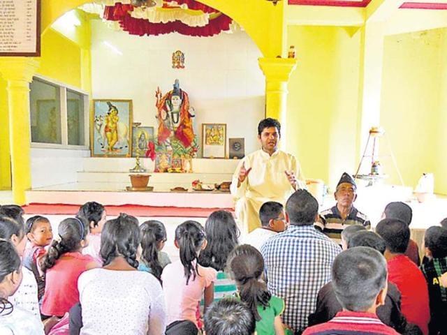 Priest-Bishnu-Prasad-Subedi-delivering-his-Sunday-sermon-in-Aizawl-s-Thuampui-Om-Temple-Pratap-Chhetri-HT-photo