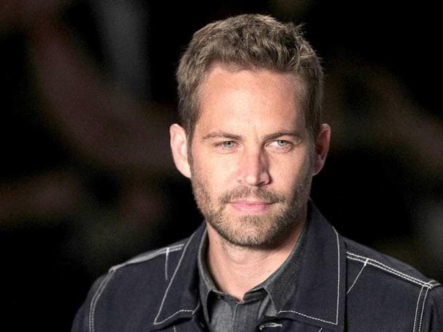 First-responders-gather-evidence-near-the-wreckage-of-the-Porsche-sports-car-that-crashed-into-a-light-pole-on-Hercules-Street-near-Kelly-Johnson-Parkway-in-Valencia-on-November-30-Paul-Walker-died-in-the-accident-AP-Photo