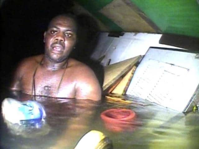Harrison-Odjegba-Okene-looks-in-awe-as-a-rescue-diver-surfaces-into-the-air-pocket-which-has-kept-Okene-alive-for-nearly-three-days-recorded-by-the-diver-s-headcam-video-the-full-impact-of-the-miraculous-encounter-becomes-plain-the-see-AP-Photo-DCN-Diving