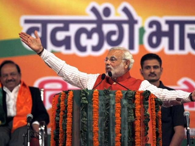 BJP leader and Gujarat chief minister Narendra Modi speaks during an election rally in Dwarka area of New Delhi. (AP)