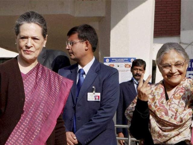 UPA chairperson Sonia Gandhi with Delhi chief minister Sheila Dikshit after casting votes for Delhi Assembly elections at Nirman Bhawan polling station in New Delhi. (PTI)