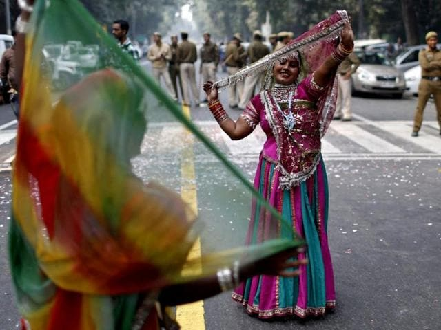 Dancers perform during the celebrations outside the headquarters of India