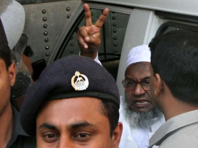 Abdul-Quader-Molla-64-the-fourth-highest-ranked-leader-of-the-Jamaat-e-Islami-party-gestures-at-the-central-jail-in-Dhaka-AFP-Photo