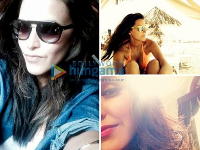 Neha likes to flaunt a good time spent at the beach with sun-kissed sands and hot tan. After all, it