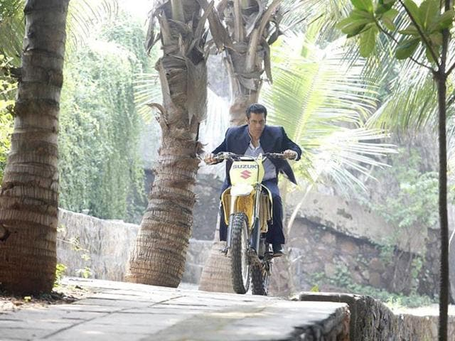 Salman Khan rides a bike in a still from Jai Ho.