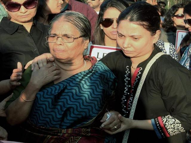 Mother-and-wife-of-Captain-Sunil-James-during-a-protest-to-press-for-his-release-in-Mumbai-PTI-Photo