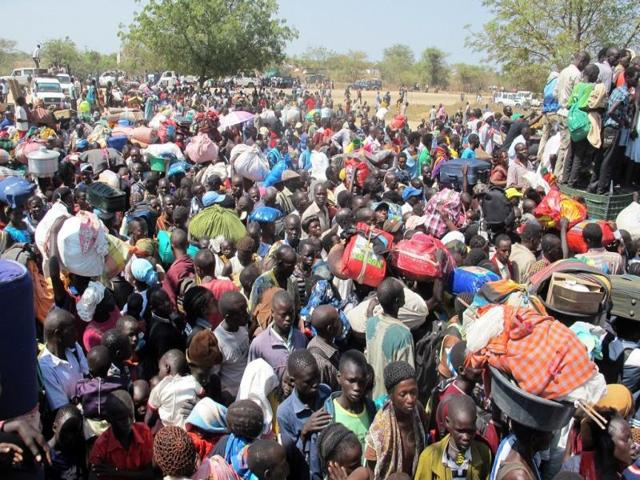 A-handout-photo-from-UNMISS-showing-civilians-gathered-outside-the-UNMISS-compound-in-Bor-AFP-Photo