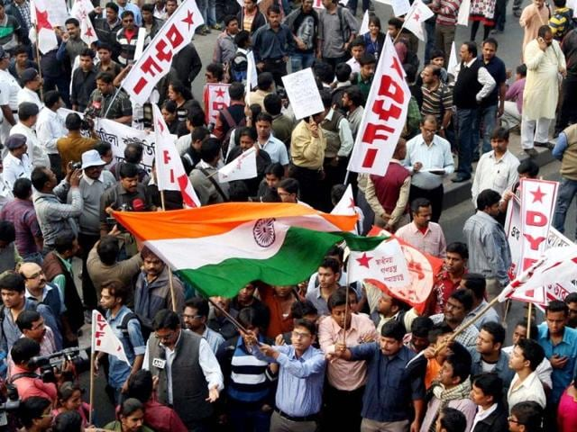 Students participate in a march to American consulate in Kolkata to protest against the alleged ill-treatment of India