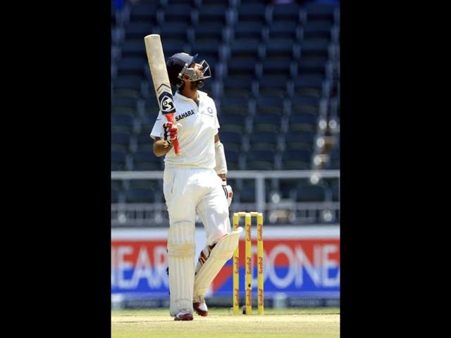 Cheteshwar-Pujara-raises-his-bat-after-reaching-150-runs-during-the-second-innings-of-the-first-Test-against-South-Africa-at-Wanderers-stadium-in-Johannesburg-AP-Photo