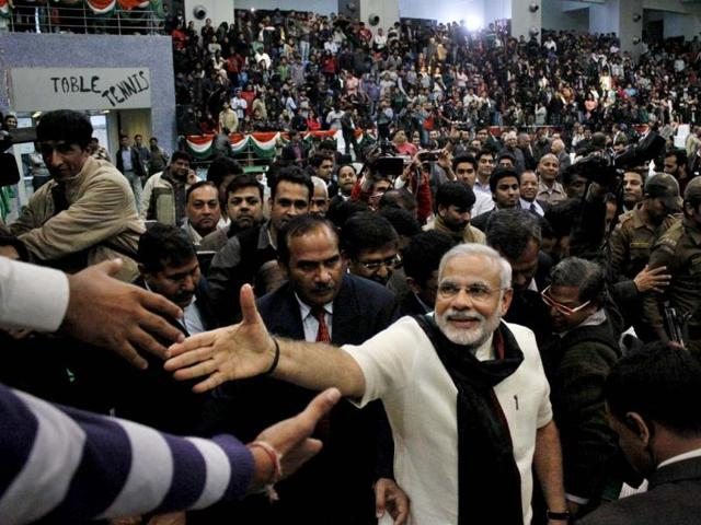 Gujarat-chief-minister-Narendra-Modi-speaks-at-Sneh-Milan-Samaroh-in-Surat-PTI-Photo