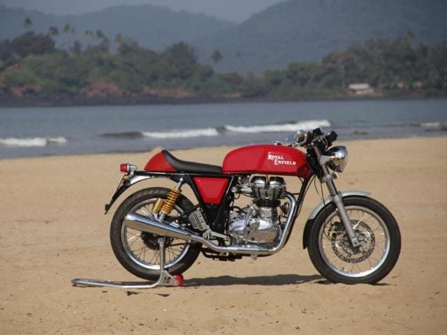 This-photograph-shows-the-new-Continental-GT-model-by-Royal-Enfield-on-a-beach-at-Canacona-district-in-Goa-during-a-launch-event-for-the-Indian-market-Motorbike-manufacturers-are-riding-a-wave-of-swinging-60s-nostalgia-with-new-models-seeking-to-capture-revived-interest-in-the-classic-looks-of-the-period-with-demand-helped-by-fashionista-in-chief-David-Beckham-Photo-AFP
