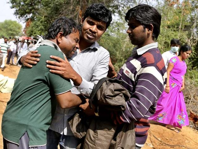 A man is consoled by others after news of the death of his wife and father-in-law among passengers in the train accident at Kothacheruvu, near Bangalore. (AP)