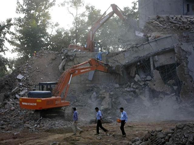 Excavators-work-at-the-site-of-a-collapsed-building-that-was-under-construction-in-Canacona-town-Goa-Reuters
