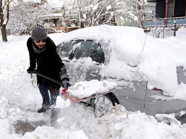 Brad Sachs shovels snow from around his car near his home in Indianapolis, Indiana. A blast of Arctic air gripped the vast middle of the United States, bringing the coldest temperatures felt in two decades, causing at least four deaths, forcing businesses and schools to close and canceling thousands of flights. (Reuters)