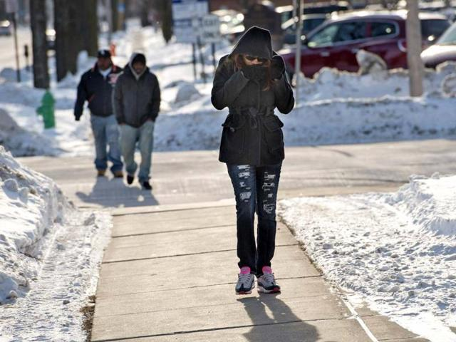 People walk into the wind outside the Brown County Courthouse in Green Bay, Wisconsin. Temperatures were 20 to 40 degrees F (11-22 degrees C) below average in parts of Montana, North and South Dakota, Minnesota, Iowa, Wisconsin, Michigan and Nebraska, according to the National Weather Service. (Reuters)