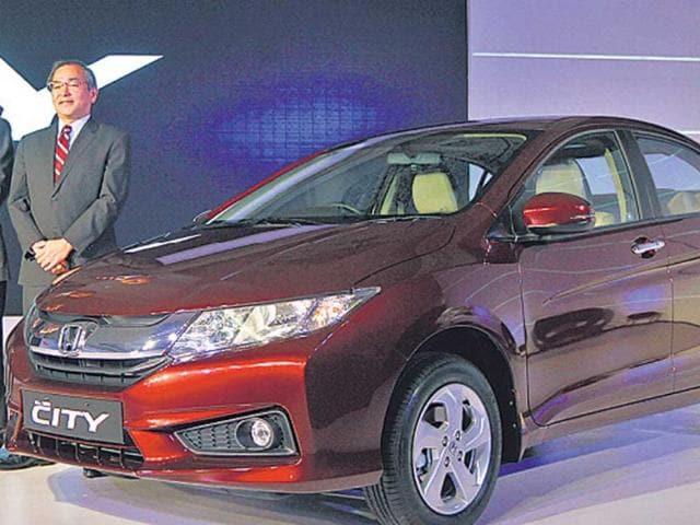 Managing-officer-of-Honda-Motor-Co-Yoshiyuki-Matsumoto-poses-with-the-new-4th-generation-City-sedan-in-New-Delhi-Virendra-Singh-Gosain-HT-photo