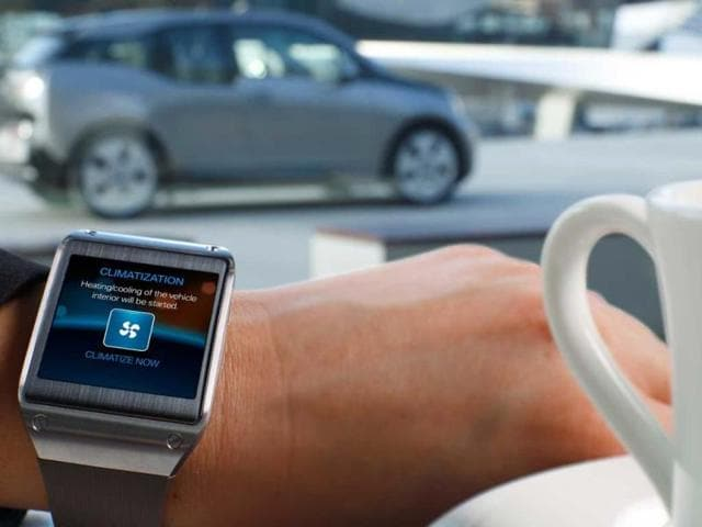 BMW unveils smartwach app at CES,German carmaker,Samsung's Galaxy Gear