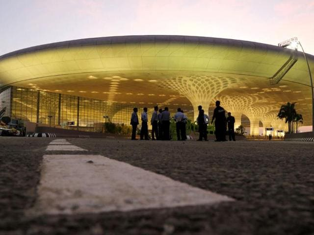 Indian security personnel stand outside T2, the new integrated terminal at Chhatrapati Shivaji International Airport, during its inauguration. AP