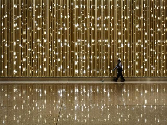 An airport staff employee cleans the floor inside newly constructed Terminal 2 at Chhatrapati Shivaji International Airport. REUTERS