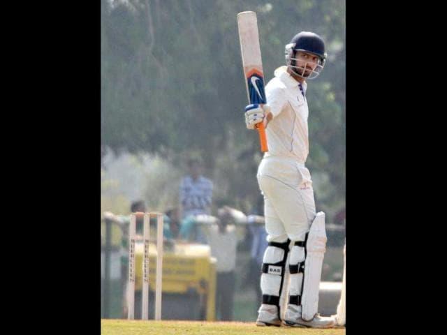 Punjab-s-Mandeep-Singh-scored-101-in-the-second-inning-against-J-amp-K-in-Ranji-Trophy-quarter-final-match-at-Vadodara-PTI-Photo