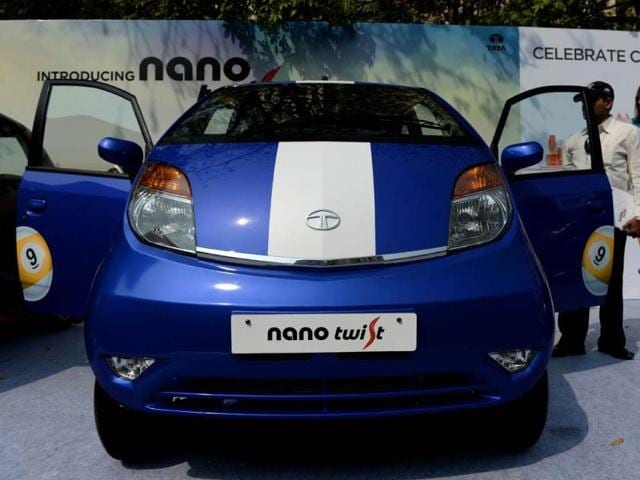 A-visitor-inspects-the-new-Nano-Twist-motor-car-after-the-launch-in-Mumbai-India-s-struggling-Tata-Nano-billed-as-the-world-s-cheapest-car-launched-a-new-variant-as-the-company-Tata-Motors-looks-to-give-the-hatchback-a-new-start-AFP-PHOTO