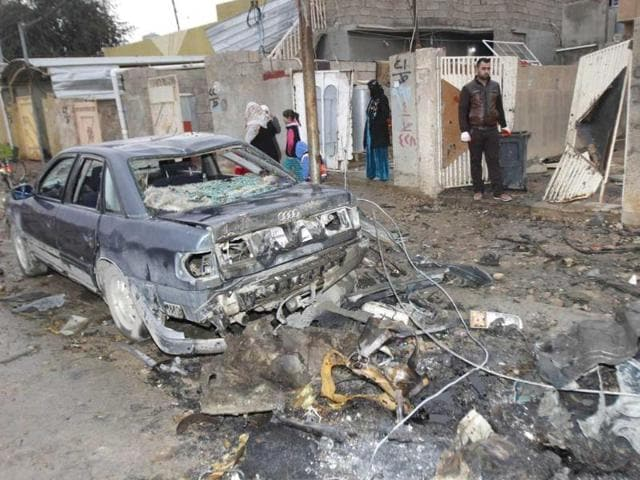 Civilians-gather-at-the-site-of-a-car-bomb-attack-in-Kirkuk-250-km-155-miles-north-of-Baghdad-A-string-of-bombings-rocked-the-ethnically-mixed-Iraqi-city-of-Kirkuk-wounding-at-least-13-people-police-and-medics-said-Reuters-Photo