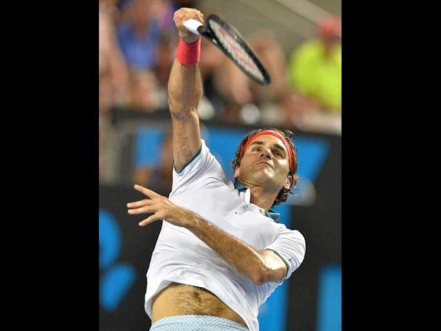 Switzerland-s-Roger-Federer-plays-a-shot-against-Slovenia-s-Blaz-Kavcic-during-their-men-s-singles-match-on-day-four-of-the-2014-Australian-Open-in-Melbourne-AFP-Photo