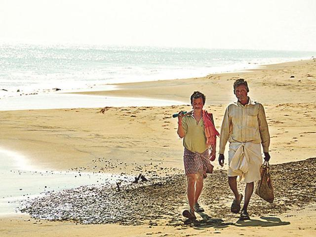 Two-villagers-walk-over-a-spot-along-Satabhaya-coast-that-was-once-a-house-HT-photo