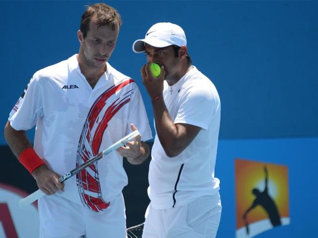 India-s-Leander-Paes-R-and-Czech-Republic-s-Radek-Stepanek-speak-during-their-men-s-doubles-match-against-Czech-Republic-s-Lukas-Rosol-and-Lukas-Dlouhy-AFP-Photo