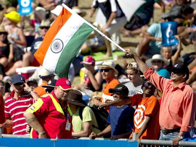An Indian fan waves the Tricolour during the first ODI between New Zealand and India at McLean Park in Napier. (AFP Photo)