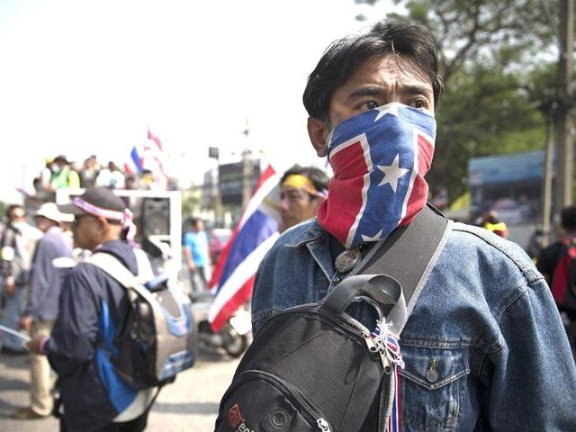 Shots, blasts as protest rivals clash on Thai election eve