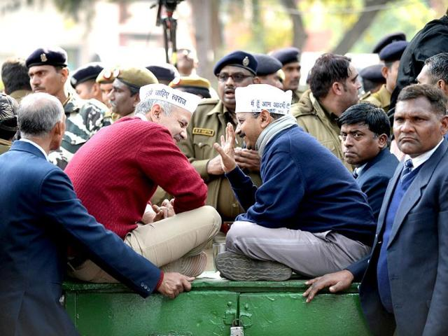 Delhi-CM-Arvind-Kejriwal-speaks-with-Delhi-s-urban-development-minister-Manish-Sisodia-during-a-protest-in-New-Delhi-Reuters-photo
