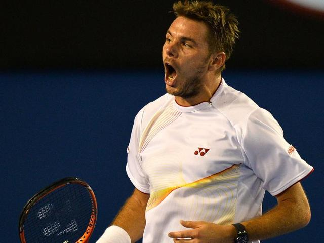 Stanislas-Wawrinka-of-Switzerland-celebrates-beating-Tomas-Berdych-of-the-Czech-Republic-in-their-men-s-singles-match-on-day-11-of-the-2014-Australian-Open-tennis-tournament-in-Melbourne-AFP-Photo