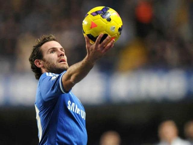 Spanish-midfielder-Juan-Mata-holds-the-ball-up-during-an-English-Premier-League-football-match-between-Chelsea-and-Swansea-City-AFP-Photo