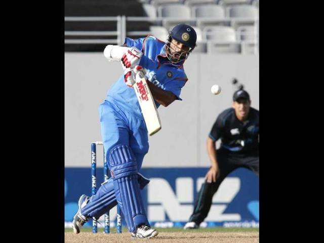Shikhar Dhawan hits a six during the third ODI against New Zealand at the Eden Park in Auckland. (AFP Photo)
