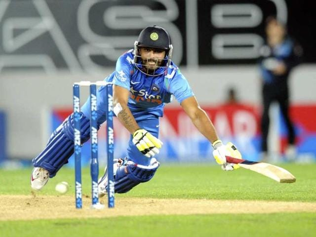 Ravindra Jadeja dives to make his ground against New Zealand during the third ODI at the Eden Park in Auckland. (AP Photo)