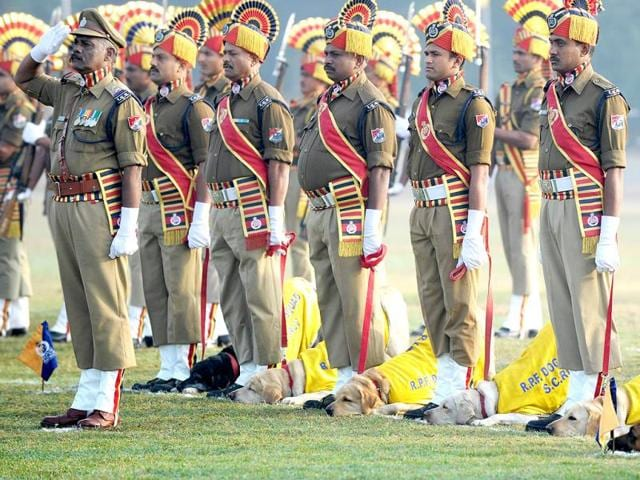 Railway Protection Force (RPF) Dog Squad personnel take part in a march during Republic Day celebrations in Secunderabad, the twin city of Hyderabad, on January 26, 2014. AFP PHOTO