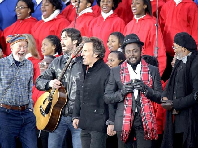 A file photo shows from left, Pete Seeger, his grandson Tao Rodriguez-Seeger, Bruce Springsteen, will.i.am, and Samuel L Jackson perform at the We Are One: Opening Inaurgural Celebration at the Lincoln Memorial in Washington.