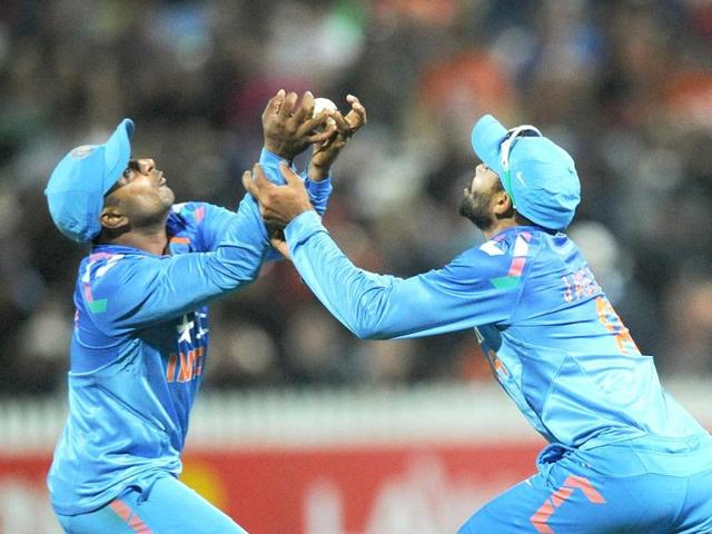 Ambati Rayudu (L) and Ravindra Jadeja clash as they drop a catch off the bat of New Zealand