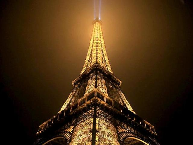 The-Eiffel-tower-is-seen-on-a-foggy-night-in-Paris-The-tower-was-completed-in-1889-and-it-s-current-total-height-is-324-meters-AFP-photo
