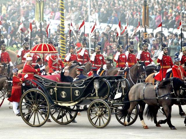 President Pranab Mukherjee waves as he arrives in a ceremonial buggy for the