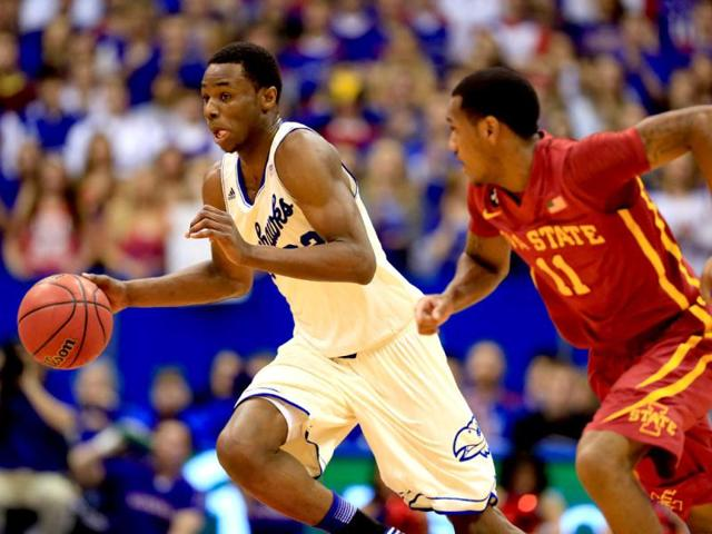 Andrew Wiggins of the Kansas Jayhawks controls the ball as Monte Morris of the Iowa State Cyclones defends during the game at Allen Fieldhouse in Lawrence, Kansas. (AFP Photo)