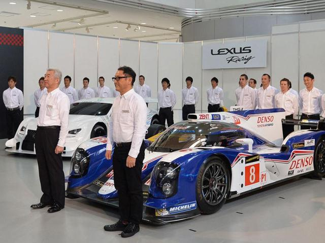 Japan's Toyota Motor Corp president Akio Toyoda (front R) and its racing teams' exclusive drivers pose during a photo session after a press conference in Tokyo. (AFP Photo)